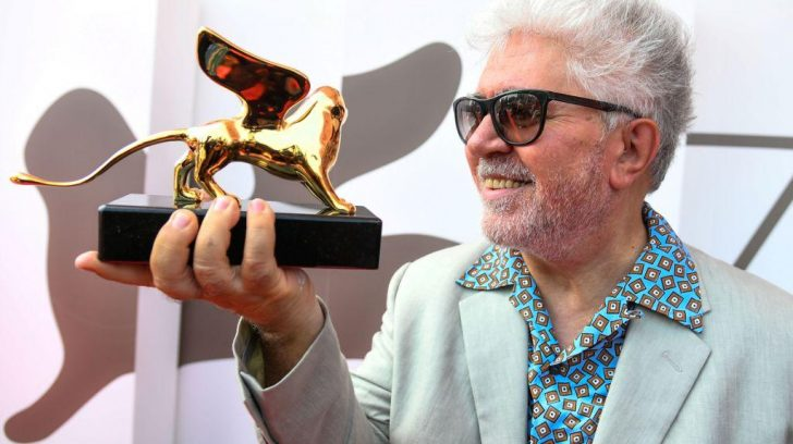 Spanish director Pedro Almodovar poses with his award on August 29, 2019 after receiving a Golden Lion for lifetime achievement during a ceremony at the 76th Venice Film Festival at Venice Lido. (Photo by Vincenzo PINTO / AFP)