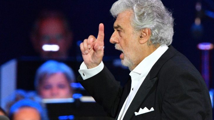Spanish tenor Placido Domingo gestures as he performs during his concert in the newly inaugurated sports and culture centre 'St Gellert Forum' in Szeged, southern Hungary, on August 28, 2019. (Photo by Attila KISBENEDEK / AFP)