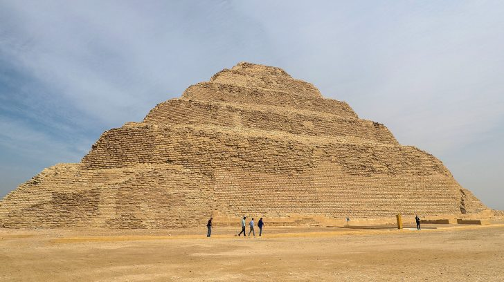 """A general view shows the step pyramid of Djoser in Egypt's Saqqara necropolis, south of the capital Cairo, on March 5, 2020. - Egyptian authorities inaugurated the famed step pyramid of Djoser,one of the earliest built in the country's ancient history, after years of renovation. The 4,700-year-old structure is nestled south of Cairo in the ancient capital of Memphis, a UNESCO World Heritage site, home to some of Egypt's most fascinating monuments. Renovation works started in 2006 but was interrupted in 2011 and 2012 for """"security reasons"""" due to turmoil caused by a popular uprising that toppled late president Hosni Mubarak. (Photo by Mohamed el-Shahed / AFP)"""