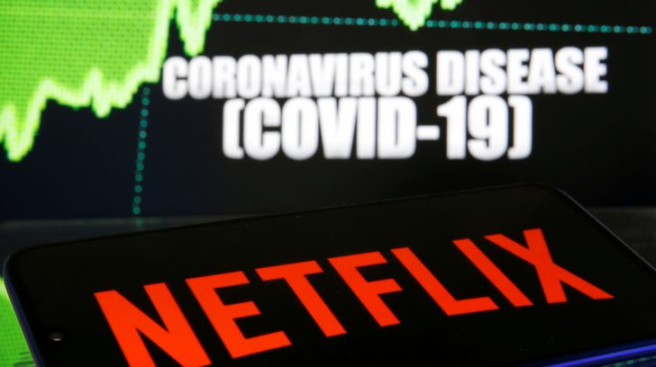 FILE PHOTO: Netflix logo is seen in front of diplayed coronavirus disease (COVID-19) in this illustration taken March 19, 2020. REUTERS/Dado Ruvic/Illustration/File Photo