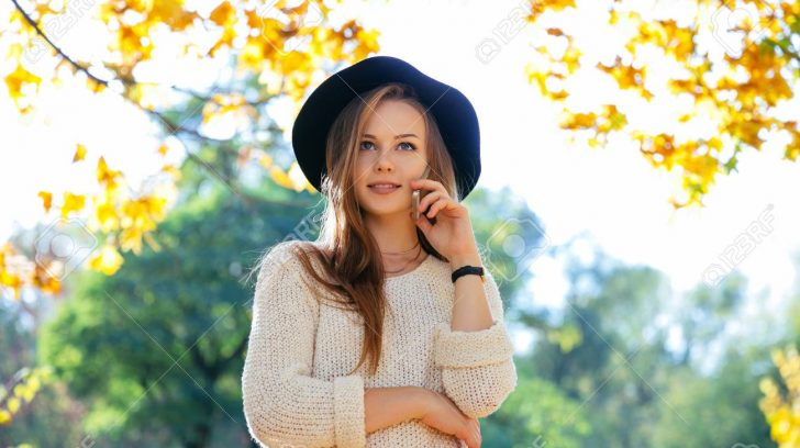 Happy teen girl walking on autumn park. Happy relax time in city. Beautiful woman, sunny day